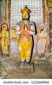 DAMBULLA SRI LANKA - DEC 27, 2016: Ancient king statues inside Dambulla Cave Temple. Cave Temple is a World Heritage Site near Dambulla city on Dec 27, 2016. Sri Lanka.
