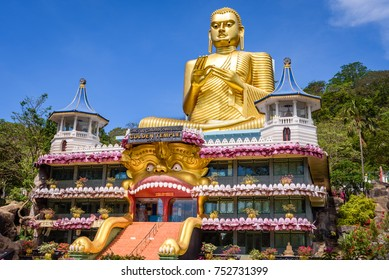 Dambulla, Sri Lanka. Golden temple in Dambulla with golden statue of Buddha with wasp on his chin on the roof near Dambulla cave temple in Dambulla, Sri Lanka.