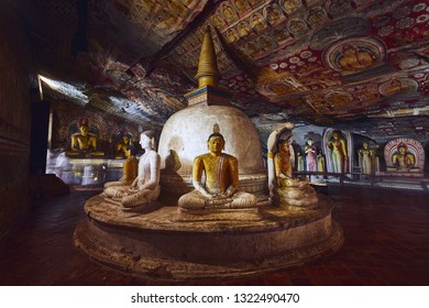 Dambulla, Sri Lanka - January 12, 2019: Statues and paintings inside  of largest and best preserved cave temple complex in Sri Lanka. Golden Temple of Dambulla on January 12, 2019.