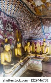 DAMBULLA, SRI LANKA - JULY 20, 2016: Buddha statues in a cave of Dambulla cave temple, Sri Lanka