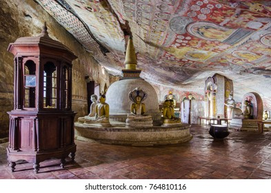DAMBULLA, SRI LANKA - MAY 30, 2015: Dambulla cave golden temple & statues on May 30 2015 in Dambulla, Sri Lanka. Dambulla cave temple is the largest and best preserved cave temple complex in Sri Lanka