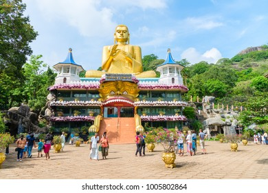 DAMBULLA, SRI LANKA - NOV 2016: Big golden Buddha statue in wheel-turning pose on the top of Golden temple and buddhist museum