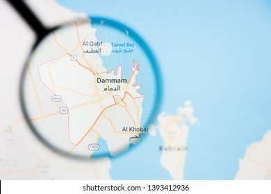 Dammam city visualization illustrative concept on display screen through magnifying glass