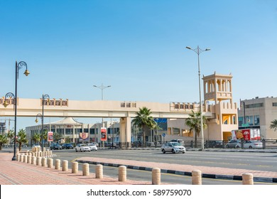 Damman, Saudi Arabia, January 9th, 2017, A footbridge with background of modern shopping mall  near the corniche park in Dammam city, Kingdom of Saudi Arabia