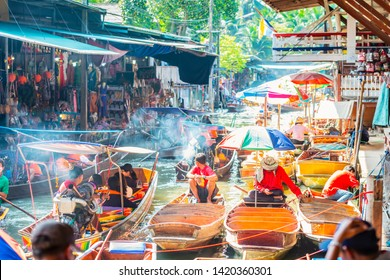 Damnoen Saduak Floating Market, tourists visiting by boat, located in Bangkok, Thailand.