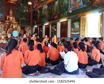 Damnoensaduak, Ratchaburi/ Thailand - July 2017 : Thai secondary students go to the temple with their teachers joining buddhist activity, giving a big candle to monk on Buddhist lent day