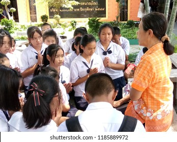Damnoensaduak, Ratchaburi/ Thailand - September 20, 2018 : Secondary students gathering for the retirement of their teacher, paying respect before the dear teacher who is 60 years of age within Sep.