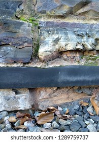 Damp proof membrane inserted into old stone wall to form a damp proof course.