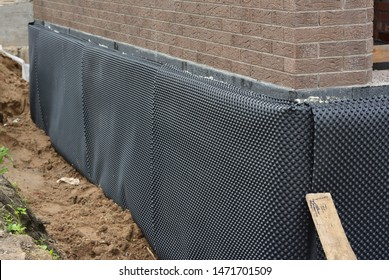 Damp proofing. House basement,foundation insulation details with waterproofing and Damp Proof membranes outdoors