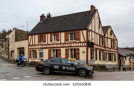 Dampierre-en-Yvelines, France - March 4, 2018: The official Skoda car is passing in front of a traditional half timbered house during Paris-Nice 2018.