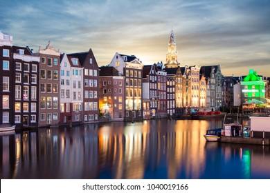 Damrak canal at sunrise, Amsterdam, Netherlands