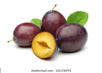 Damson plums with leaf isolated on white background