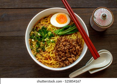 Dan dan, or tan tan noodles are a noodle dish originating from Chinese Sichuan cuisine. It consists of wheat noodles in spicy soup topped with seasoned  ground pork.