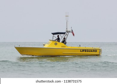 Dana Point, California/United States, July 17, 2018: State Parks Lifeguard patrolling during strong riptides