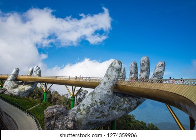Danang, Vietnam - December 2, 2018: The Golden Bridge with blue sky on Ba Na Hill in Danang, Vietnam. Ba Na Hill mountain resort is a favorite destination for tourists for travel.