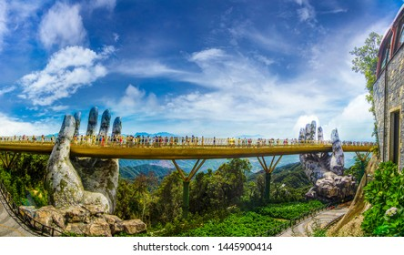 Danang, Vietnam - July 7th, 2019: The Golden Bridge is lifted by two giant hands in the tourist resort on Ba Na Hill in Danang, Vietnam. Ba Na Hill mountain resort is a favorite destination.