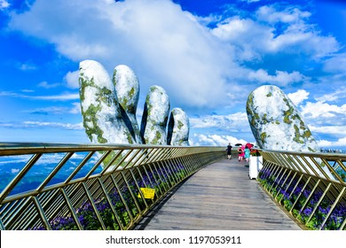 Danang, Vietnam - July 8, 2018: The Golden Bridge is in the Ba Na Hills, supported by a pair of giant hands. The bridge sits 1,400 meters above sea level, an altitude which creates the illusion.