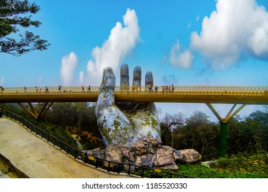 Danang, Vietnam - Sep 22th 2018: The panoramic view of Golden Bridge is lifted by two giant hands in the tourist resort on Ba Na Hill in Danang, Vietnam.