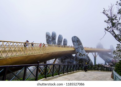 Danang, Vietnam - Sep 22th 2018: The  view of Golden Bridge is lifted by two giant hands in the tourist resort on Ba Na Hill in Danang, Vietnam.