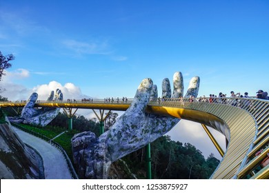 Danang,Vietnam-December5,2018:The Golden Bridge is lifted by two giant hands in the tourist resort on Ba Na Hills in Danang Vietnam. Ba Na Hills mountain resort is a favorite destination for tourists.