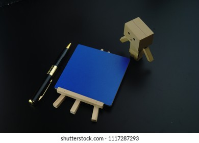 Danbo. A cute danbo board with notes board blue and pen.