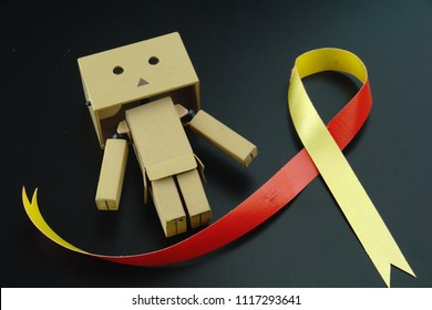 Danbo. A cute danbo board with Red yellow ribbon awareness on helping for World hepatitis day, HIV/ HVC co-infection