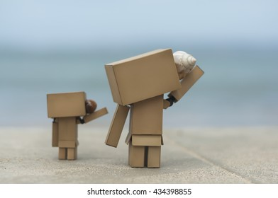 Danbo with his kid on a tropical beach at Venezuela