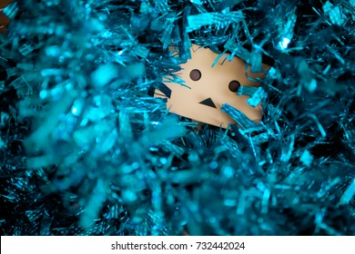 Danbo with tinsel. Christmas and New Year image.