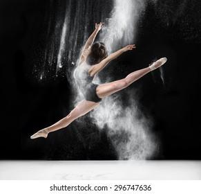 dance, ballet, beauty - ballerina dancing with flour, jump