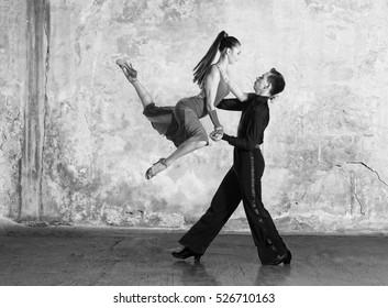 Dance beautiful couple dancing ballroom dancing on wall background
