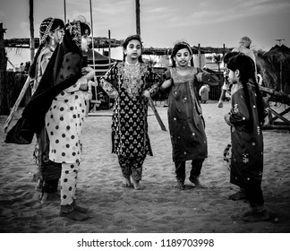 A dance by young girls for fun while playing. Abu Dhabi, UAE. Photographed in Sheikh Zayed Heritage Festival on 23/11/2017