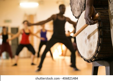 Dance class with instructor and close up of African drums