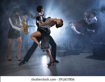 Dance couple dancing ballroom dancing to a live band sounds
