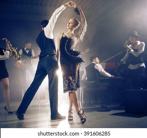 Dance couple dancing to a live band sounds