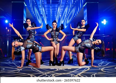 dance group of sexy young woman in costume, at the disco