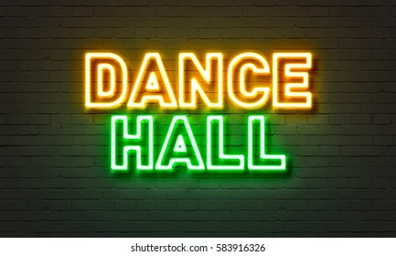 Dance hall neon sign on brick wall background
