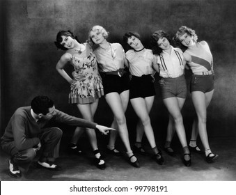 Dance instructor instructing five young women