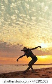 Dance and jump beautiful female silhouette on outdoors background. Dawn sky enjoyment time