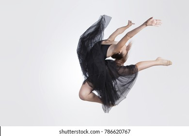 Dance jump. Girl in tutu performs element rhythmic gymnastics. Isolated on white background