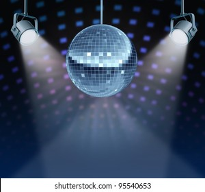 Dance night disco ball as a mirror sphere symbol of fun and dancing party in a nightclub or dance club with glowing stage lights and wall reflexions.
