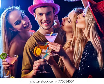 Dance party with group people dancing. How to be an alpha male at a club. Women and confident casual smiling man have fun in night club. Seduce boozy woman drink alcohol coktail and cuddles up guy .