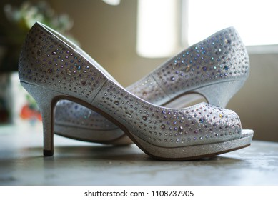 dance shoes with gem stones and glitter on a table
