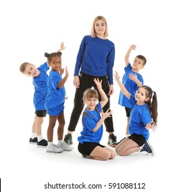 Dance teacher with children posing on white background