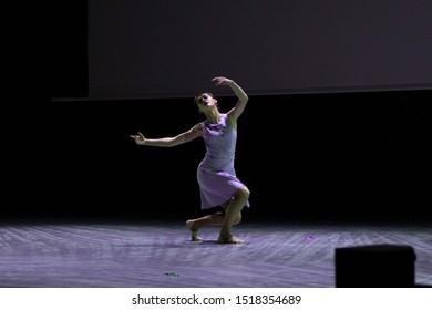 Dancer actresses young woman performs on theatrical scene in the musical show dance