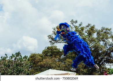 Dancer against blue sky during a dragon dance performance during Chinese new Year season China