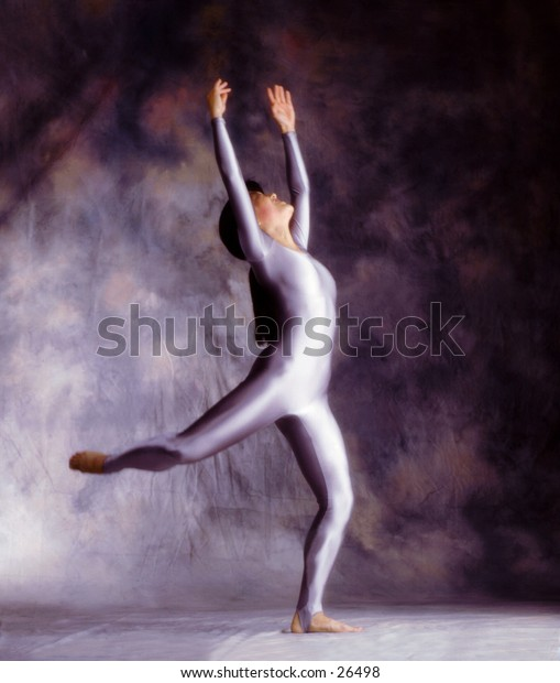Dancer with arms raised