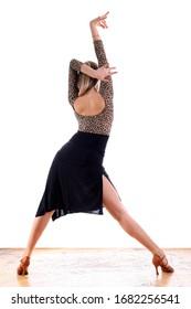 Dancer in ballroom against white background