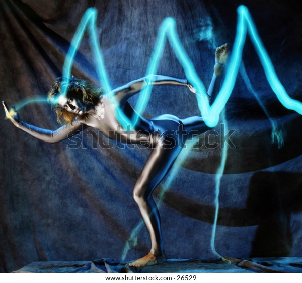 Dancer catching a beam of light. Painted silver