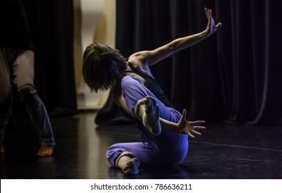 dancer. dance performance improvisation. dark bg