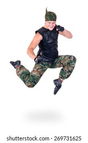 dancer dressed soldier showing some movements against isolated white background
